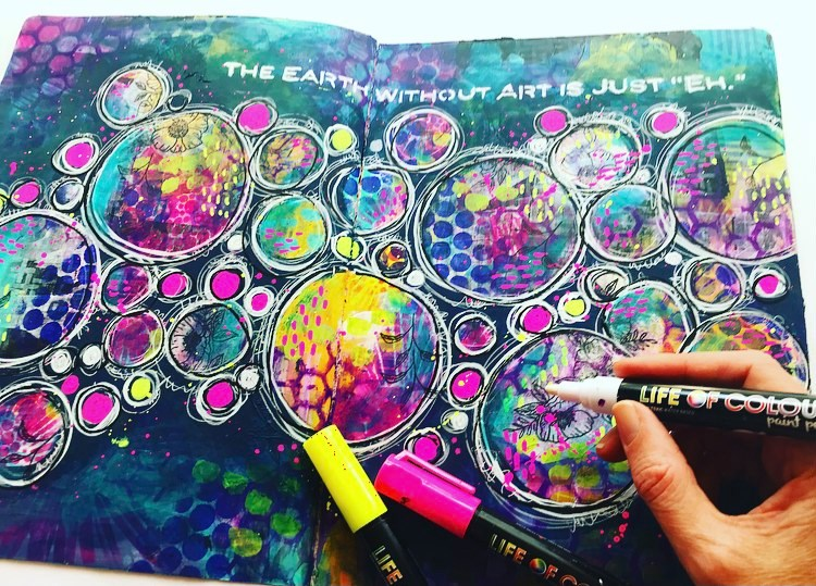 art journal page with lots of different sized circles and a navy background.