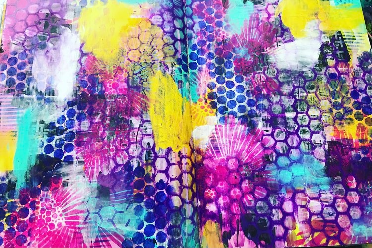 background of an art journal page with lots of stencil work. pin, blue, purple, yellow and white