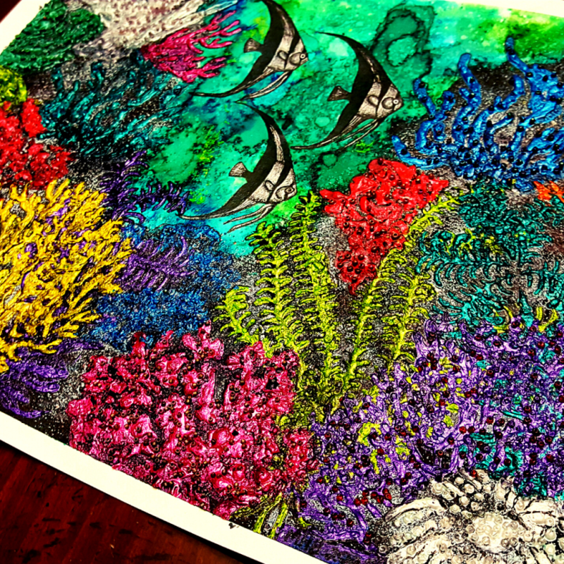 Mid range shot of the completed coral reef and angel fish art work showing approximately three-quarters of the art work. Photo is taken at an angle.