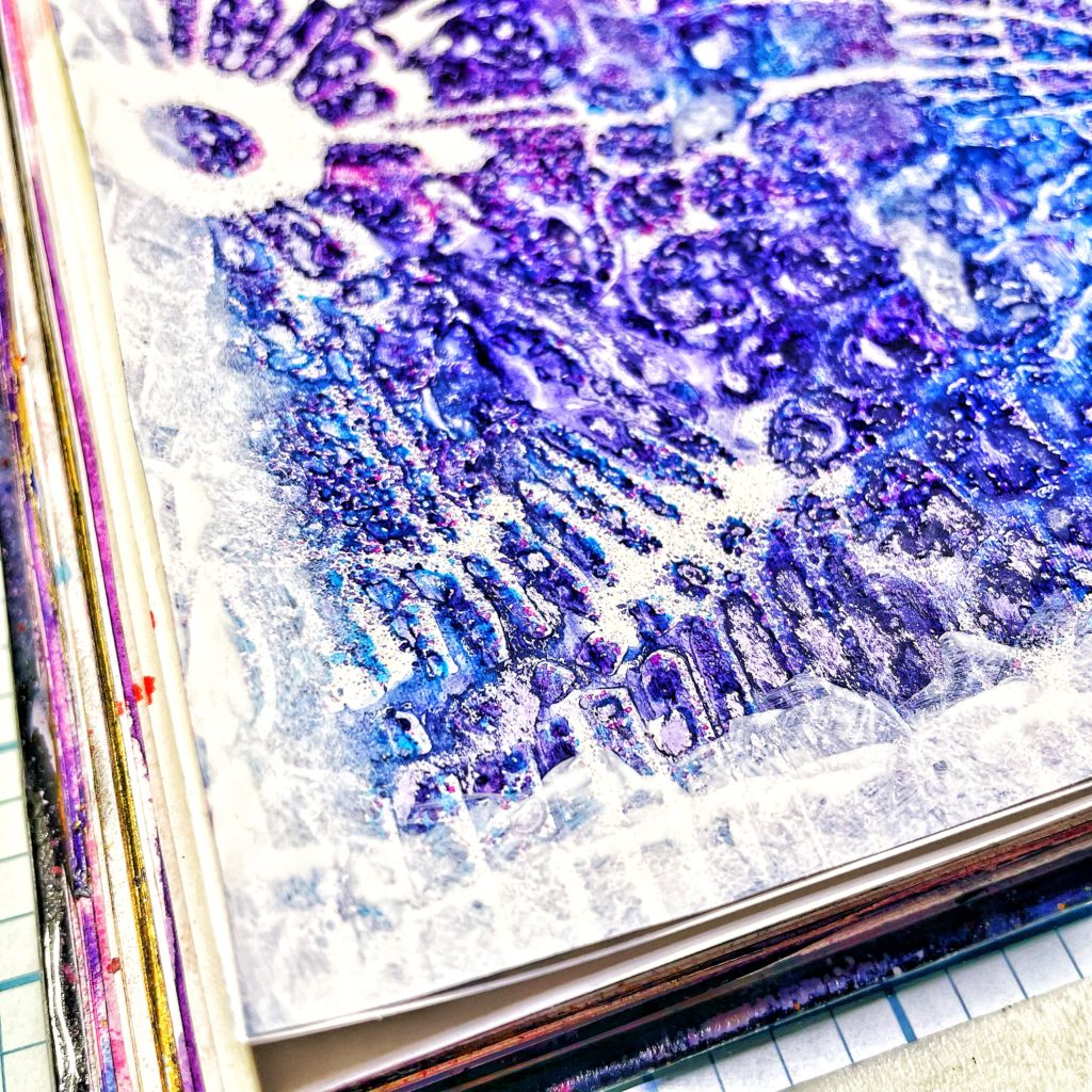 TCW 9001 White Gesso around the edges of the pages with a sponge dabber