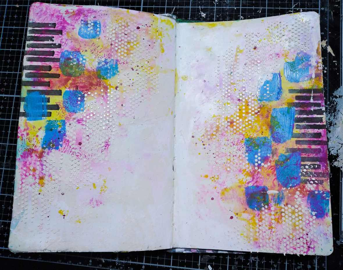 Background texture of mixed media journal spread