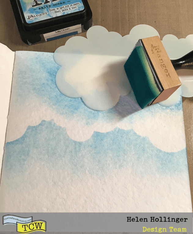 Adding clouds to my 6x6 journal using distress ink in Salty Ocean and TCW2309 Clouds Slimline Stencil to the top of my page.