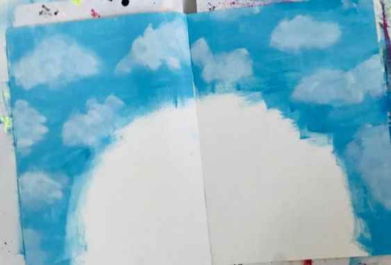 white splodges added to blue paint to create clouds