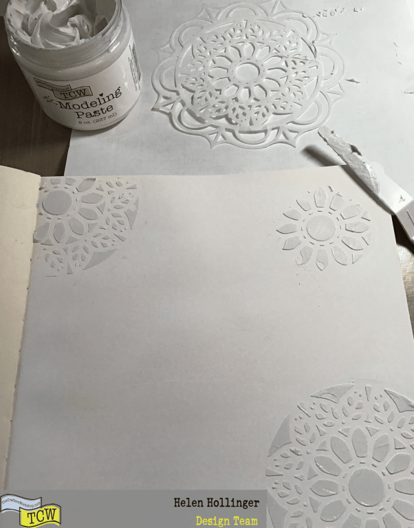 Use TCW9001 White Gesso to cover the  the whole page, then apply TCW Modeling paste through TCW905 Leaf Emblem stencil in 3 corners of the page.