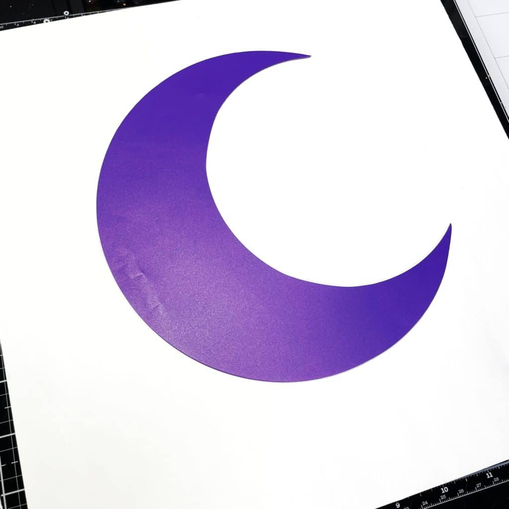 tracing around a plastic template of the moon focal point