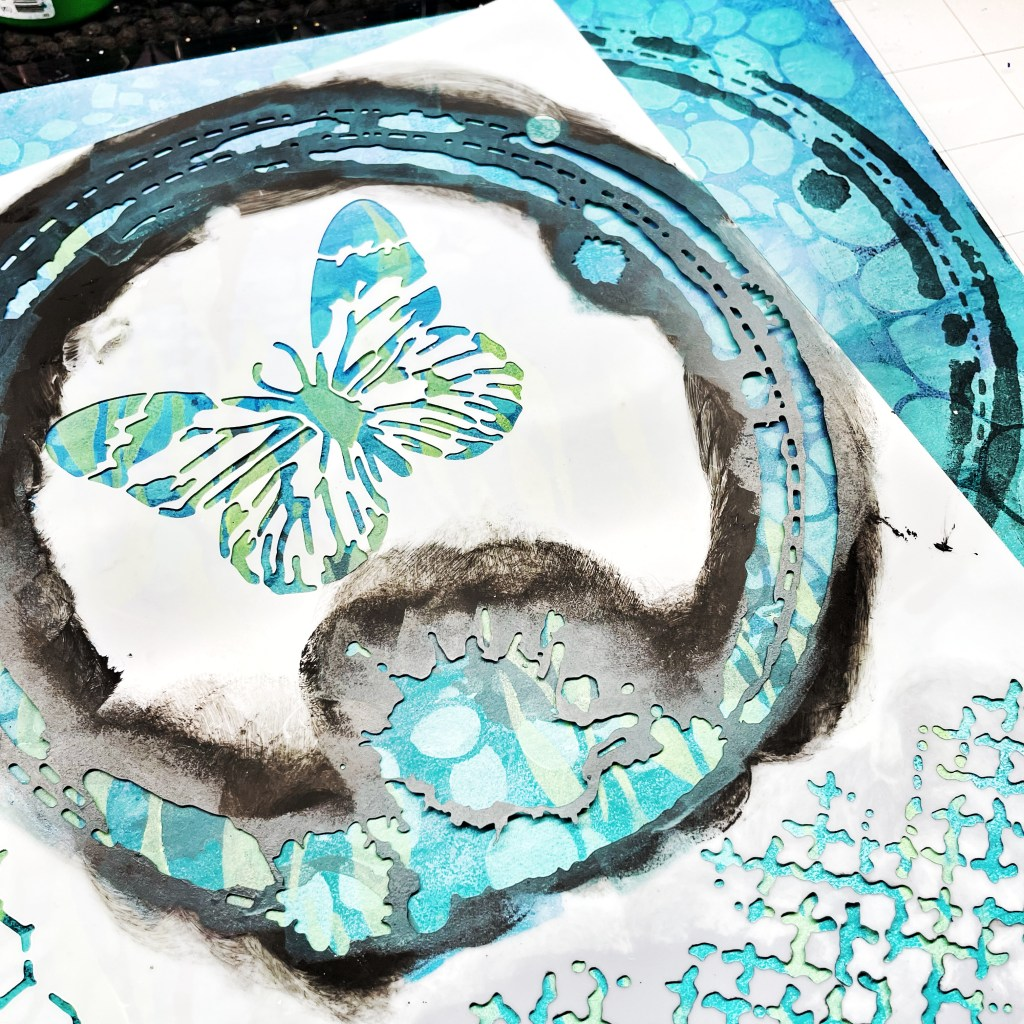 dark blue acrylic paint with a sponge through 12x12 TCW554 Butterfly Collage Stencil