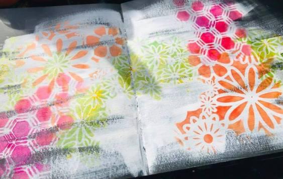 adding flower stencils in orange and lime