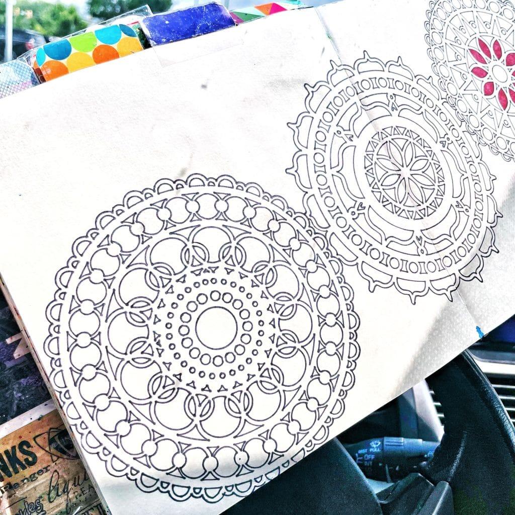 tracing through mandala stencils with thin black alcohol marker