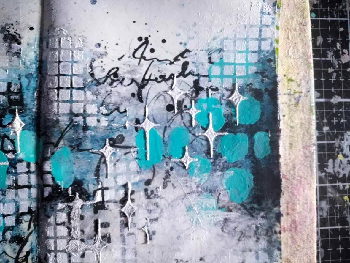 Background of art journal spread, heat embossing and stenciling