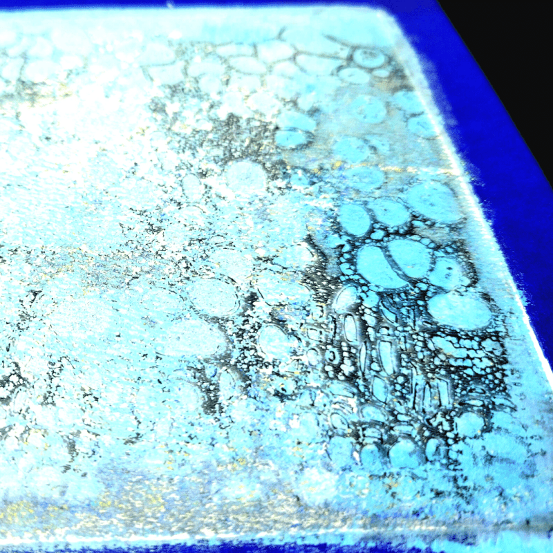 """Close up image of TCW357 Cell Theory stencil gel printed onto the 6"""" x 6"""" TCW9053 mixed media board."""