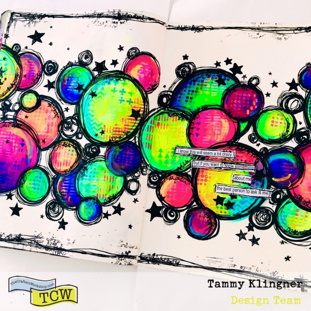 Art journal page filled with colored circles and little black stars