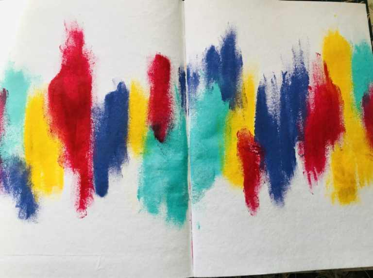 background with red, yellow, purple and aqua paint randomly applied