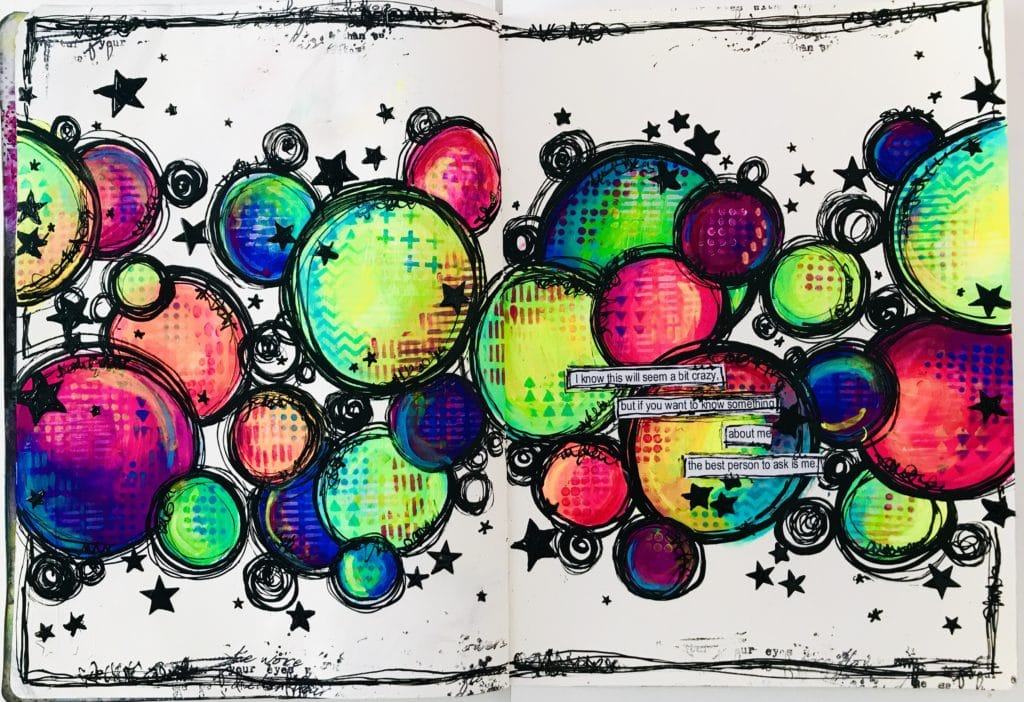 art journal page with multicolored circles and stars