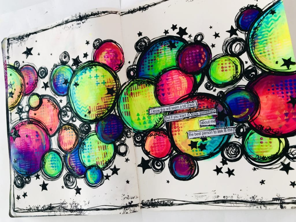 close up of art journal page with colored circles