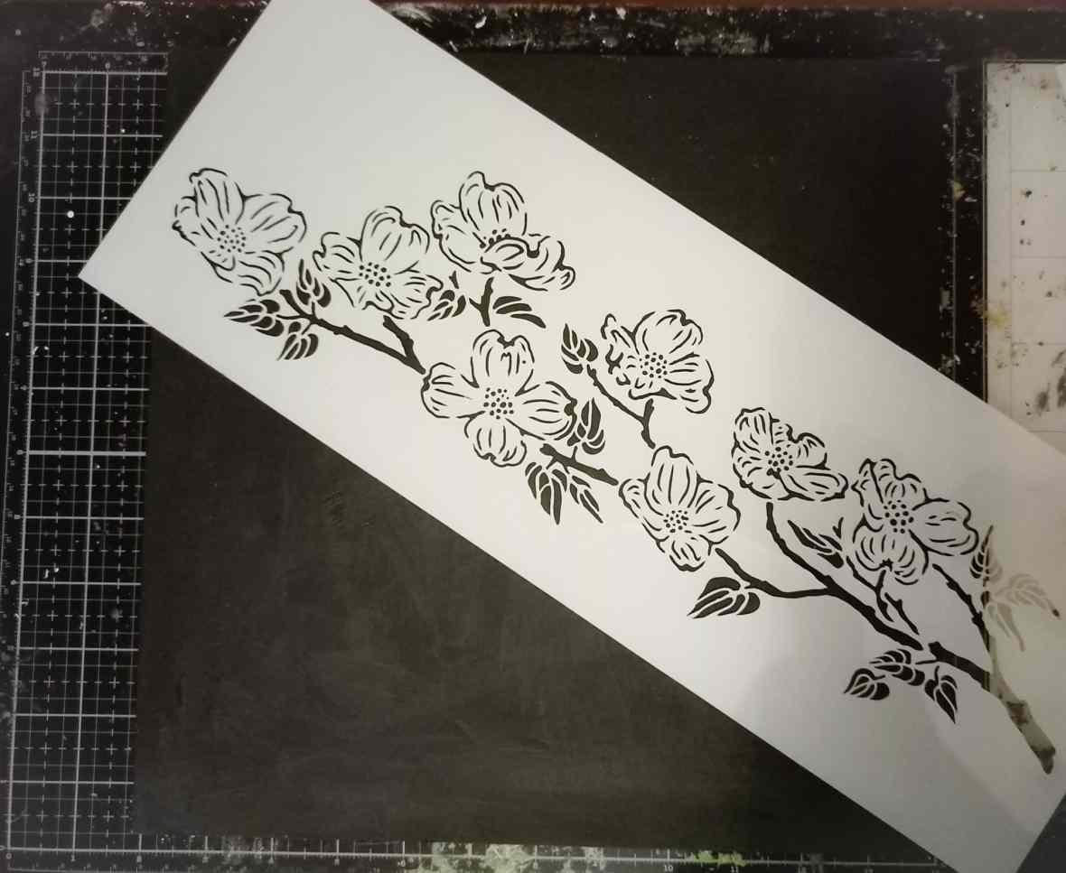 Stencil, modeling pastes, mixed media board