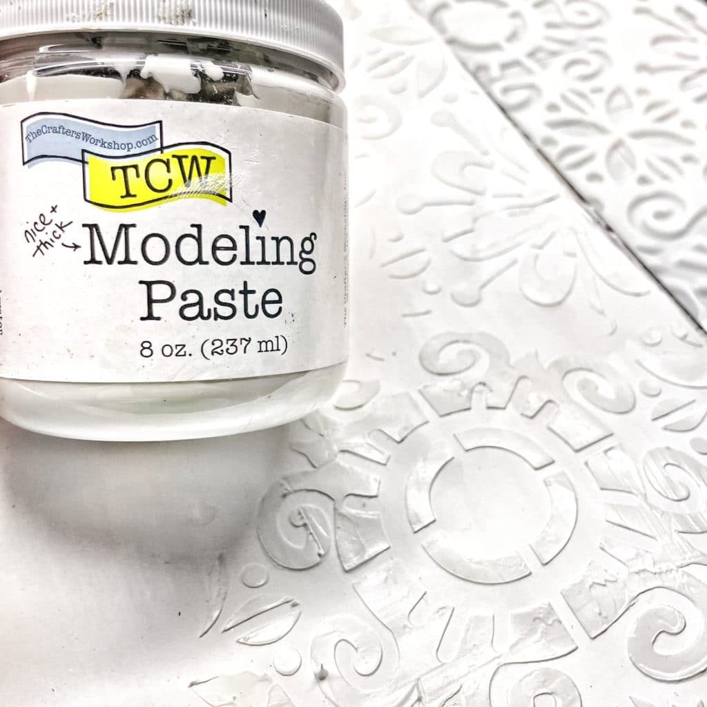 TCW9005 White Modeling Paste with a palette knife through 12x12 TCW882 Fantasy Tile Stencil