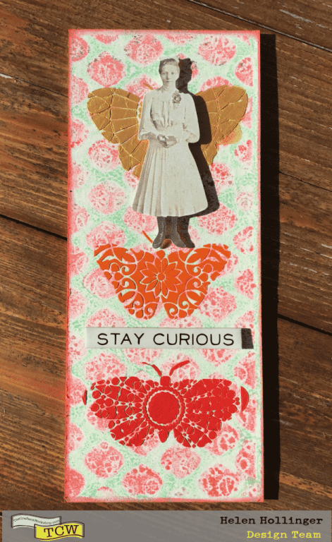 I added a chipboard doll and a sentiment. A fun little piece that sits on my desk!