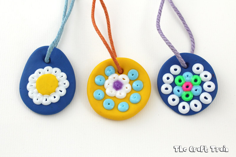 Polymer clay and hama bead pendants