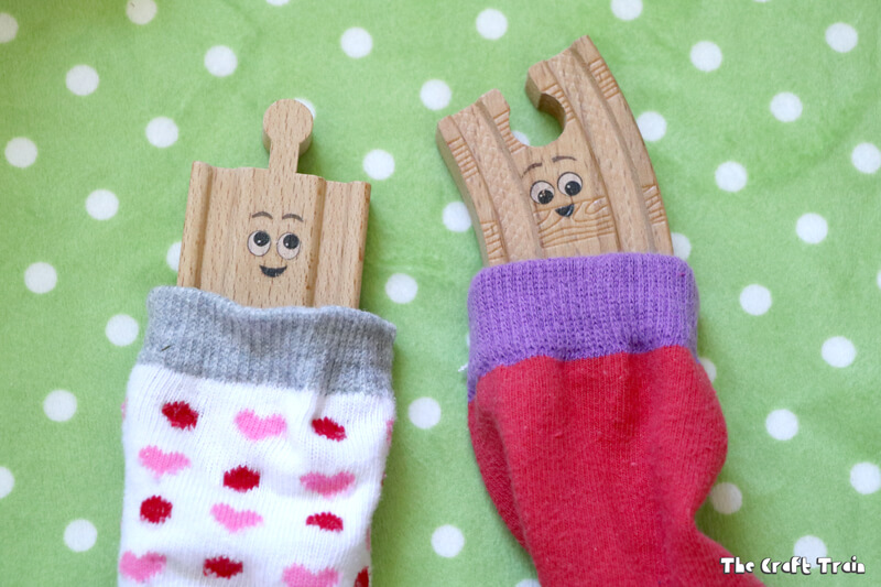 """DIY sock sleeping bags for toys! Create a camping small world for creative play. This idea is inspired by the book """"Old Tracks New Tricks"""" by Jessica Peterson"""
