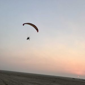 Paramotorgliding into the sunset
