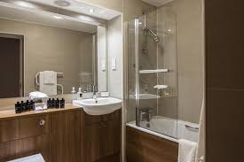 Large, opulent bathroom at The Knight Residence by Mansley.