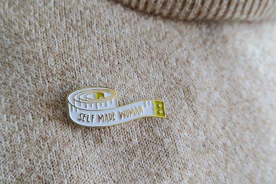 Self made woman enamel pin