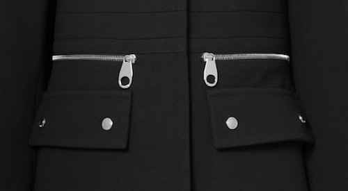 Close up photo of black coat with inset pocket detailing