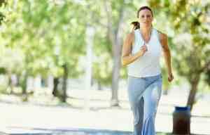 portrait of a woman jogging in a park