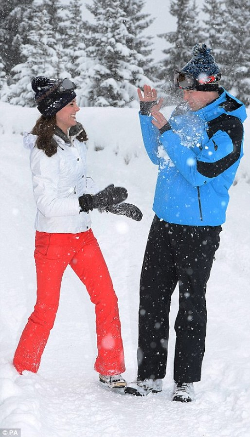 The Duke and Duchess of Cambridge have a snowball fight in new pictures. John Stillwell/PA
