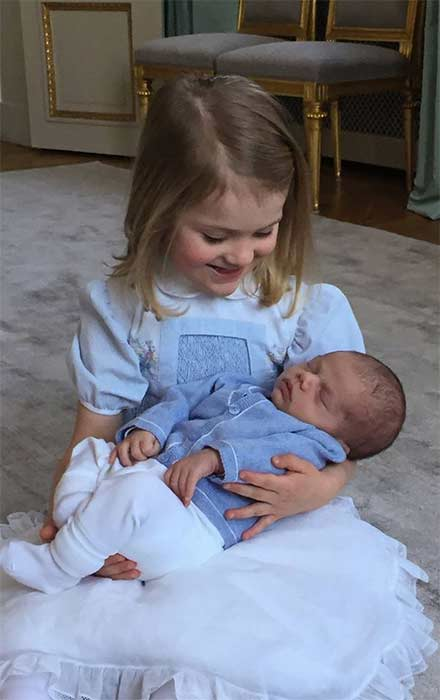 Princess Estelle cuddles her brother Oscar in a new photo. Swedish Court/Kate Gabor