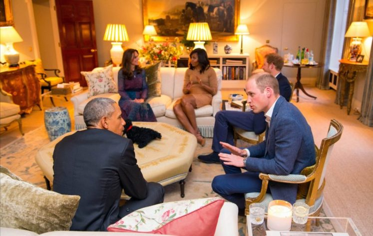 Barack and Michelle Obama talk with William, Kate and Harry in the Cambridge's drawing room at Kensington Palace. WPA/I-images