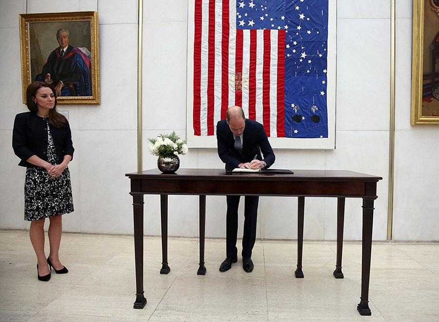 The Duke of Cambridge writes in the condolence book at the US Embassy. (PA)
