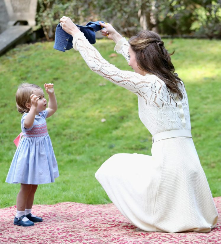 Princess Charlotte playing with her mother, Kate, Duchess of Cambridge,at a children's party yesterday. Picture by: Splash News