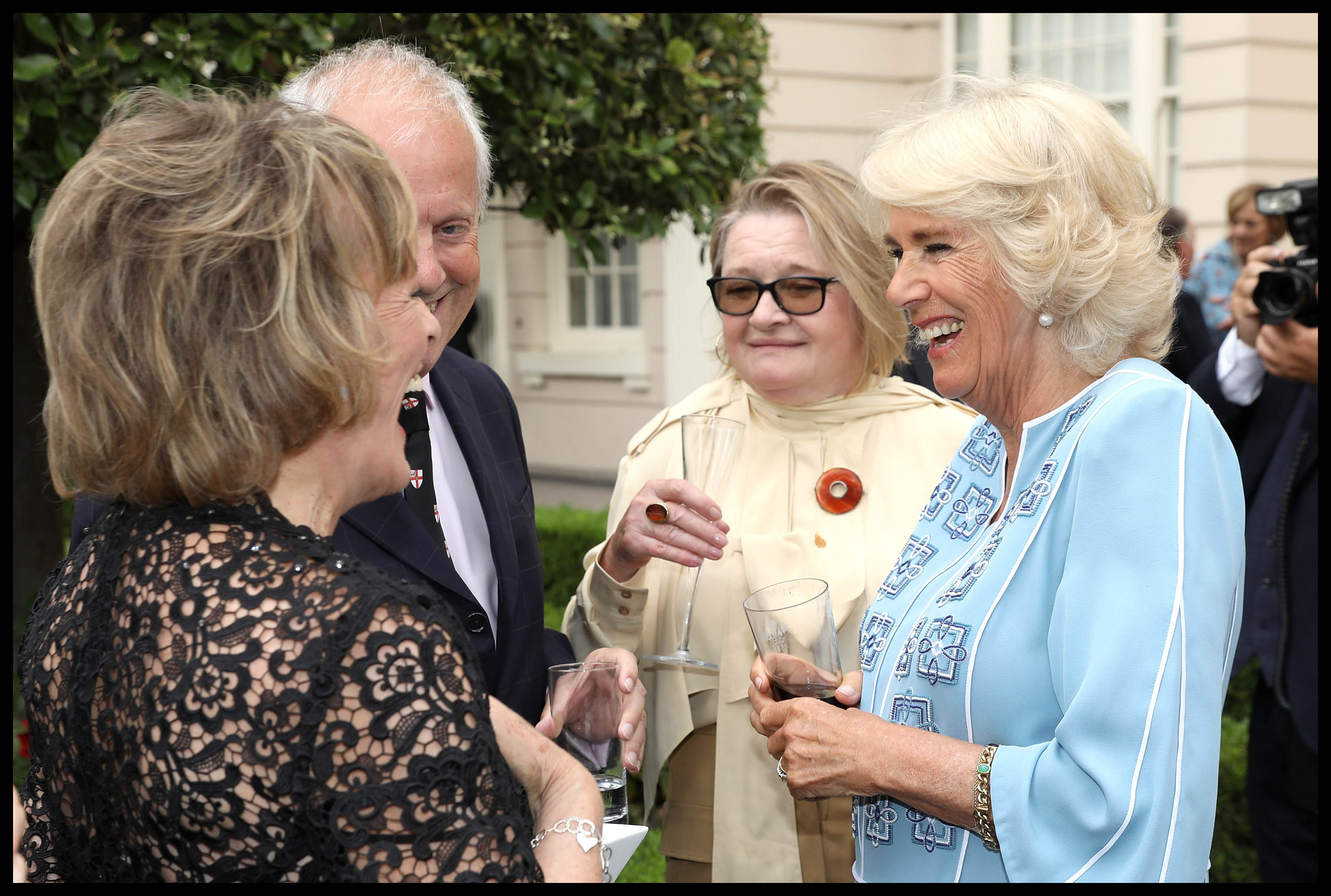 Camilla greets horses and sees cancer support charity in Aberdeen