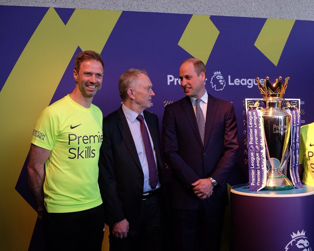 Prince William viewing Premier League trophy