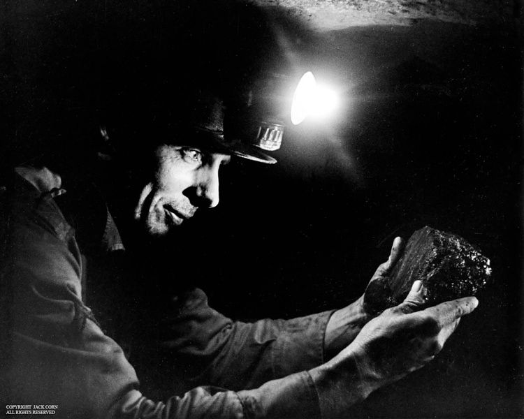 Miner holds lump of coal, Carbide lights