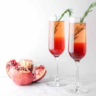 This Pomegranate Rosemary Spritzer is a fruity and herby take on a typical toast!