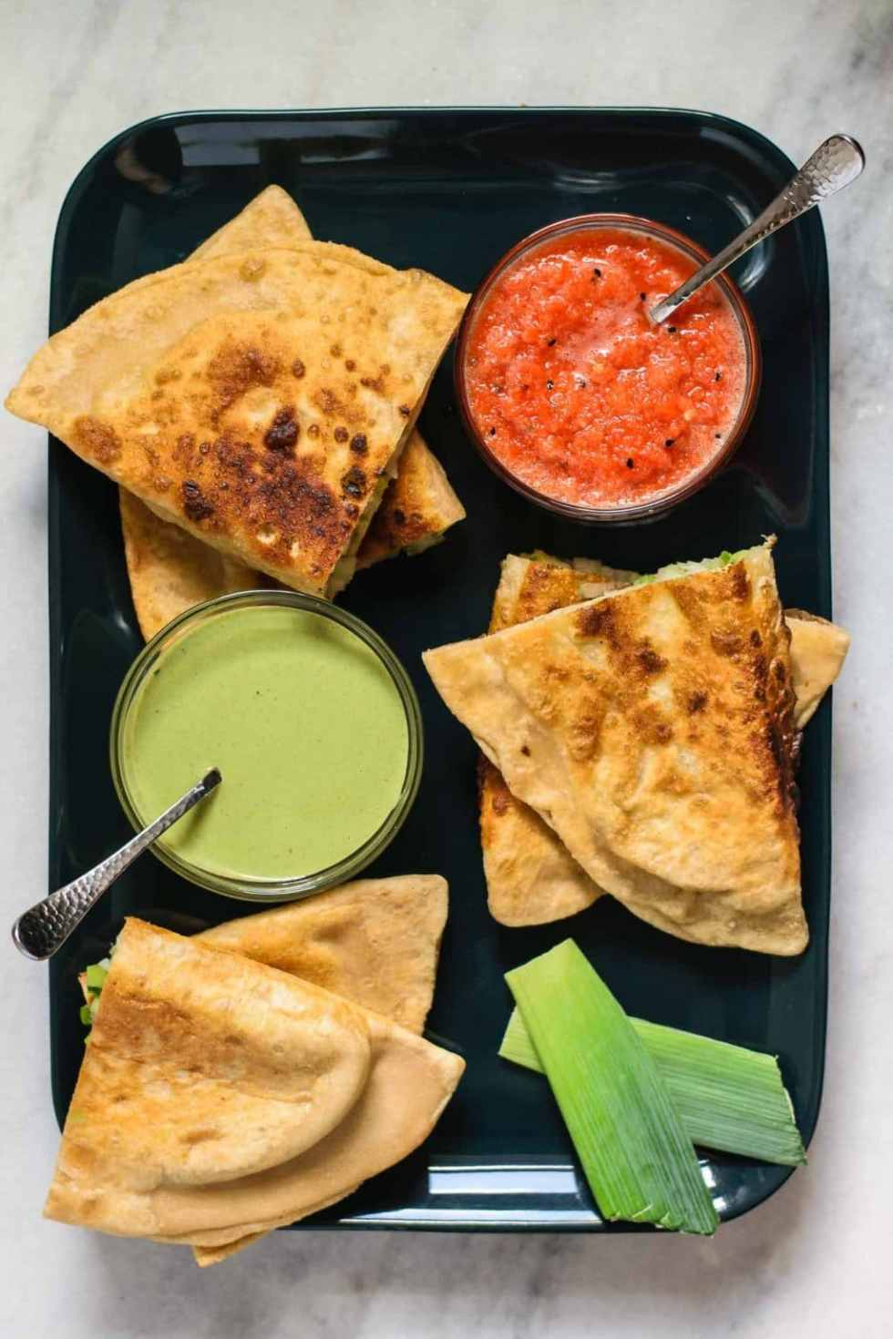 leek bolani served with coriander chutney and red pepper chutney