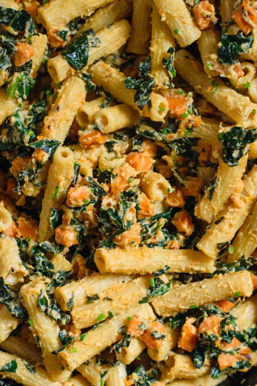 vegan tahini pasta skillet with sweet potato and kale closeup