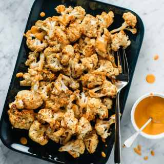 mustard roasted cauliflower with roasted red pepper drizzle
