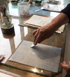 Spreading corn starch glue with a cardboard squeegee