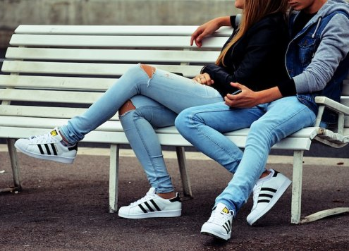 couple sitting with legs crossed
