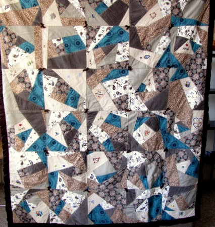 The beautiful crazy quilt my mom made for me.