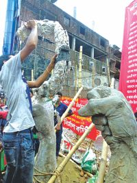 A group of youths constructing a monument at the Rana plaza collapse site in Savar yesterday.  Photo: Star