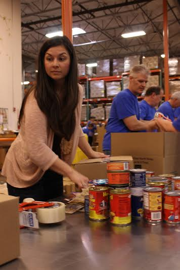 Volunteering at the North Texas Food Bank.