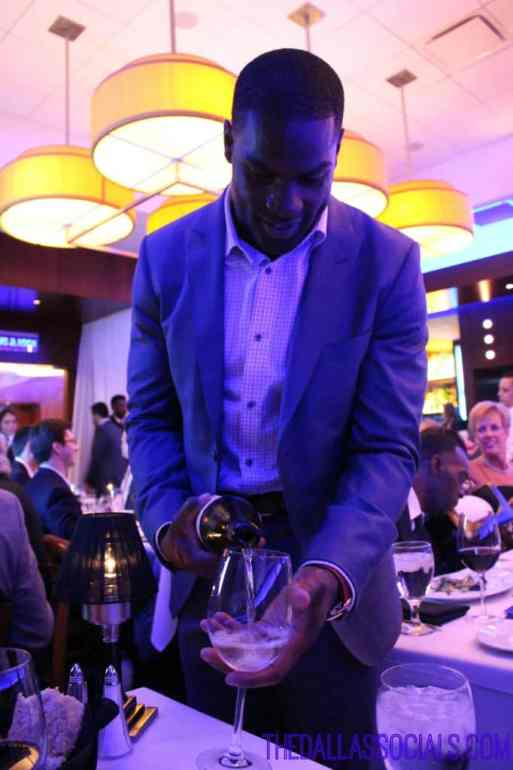 Celebrity Waiter Night - demarco murray pouring wine