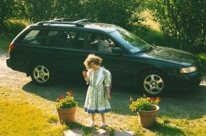 My much younger daughter in front of the much-less flattened Subaru