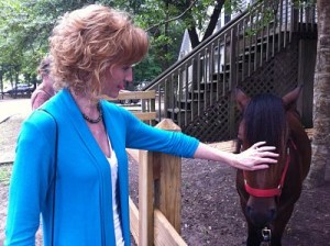 Kathryn with a rescued wild horse