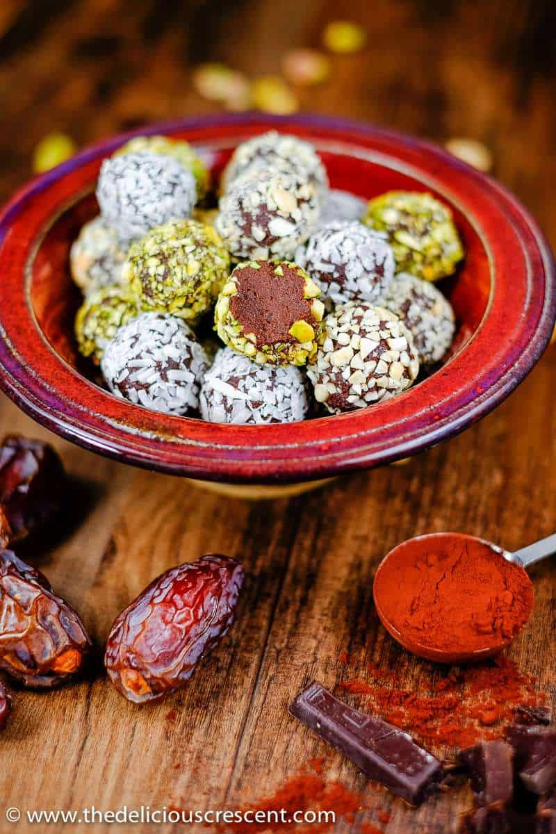 """Luscious Date Avocado Chocolate Truffles – a decadent, melt in the mouth treat, but with """"no"""" heavy cream or butter, minimal added sugar and saturated fat. Prepared with ingredients that are good sources of phytochemicals, antioxidants, vitamins and minerals."""