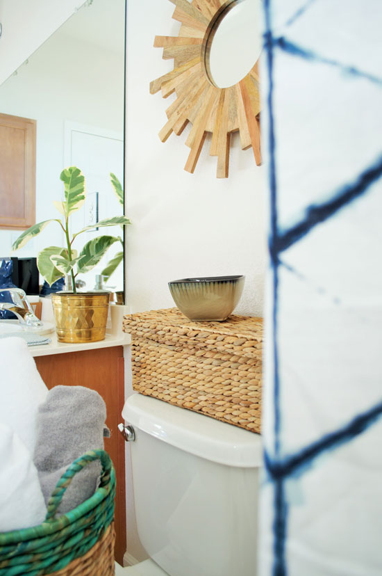 The Design Confidential New Year New Beginnings // A Shared Bath for the Boys and Shower Curtain Basket Towel Starbust Mirror Brass Blue White Shibori